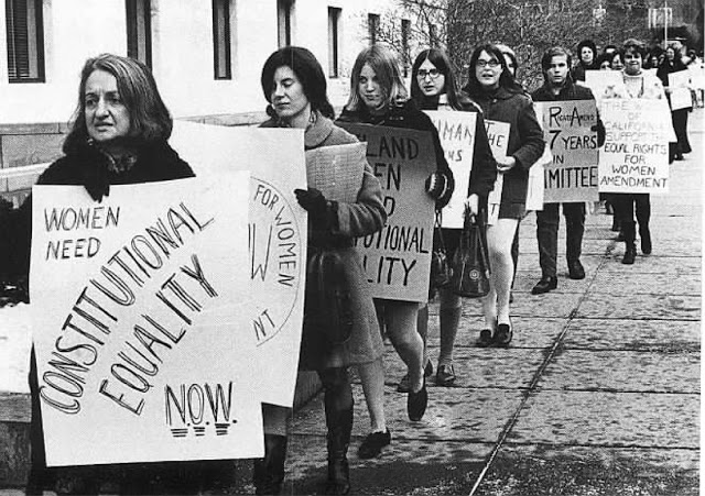 Betty Friedan leads a women protest