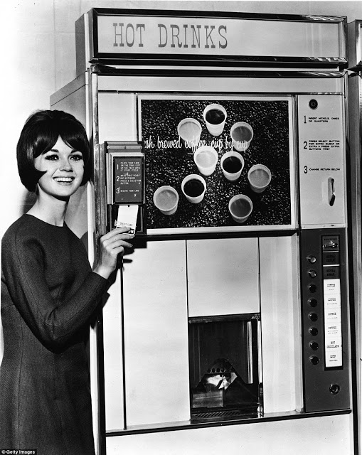 woman using credit card 1960s